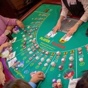 Baccarat table and players