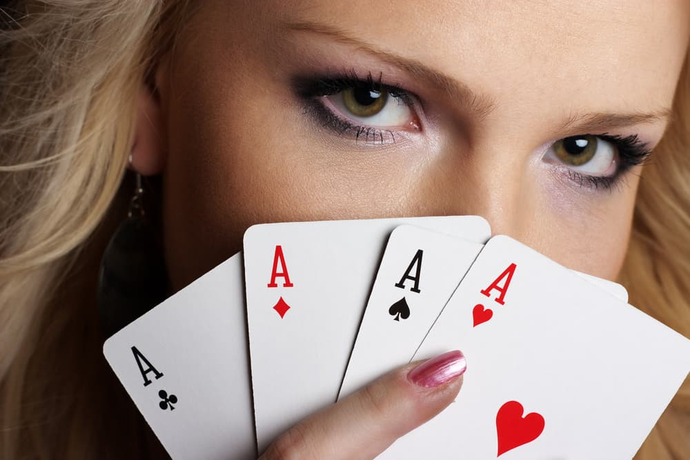 Girl's eyes and four cards